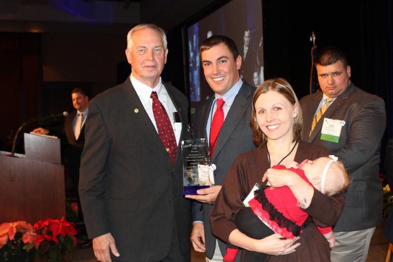 Texas Farm Bureau President Kenneth Dierschke with the 2013 Excellence in Agriculture contest winners Aaron and Amanda Low.