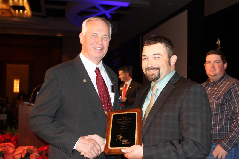 Texas Farm Bureau President Kenneth Dierschke with the winner of the 2013 Discussion Meet contest Dane Elliott of Live Oak County.