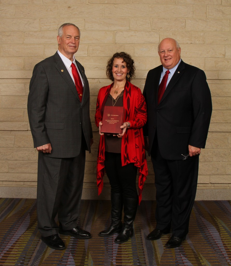 Texas Farm Bureau's 2014 Outstanding Ag in the Classroom Teacher Darla Morrow of Midland County was recognized during the organization's general session. Also pictured are TFB President Kenneth Dierschke (left) and TFB Executive Director Vernie Glasson (right).