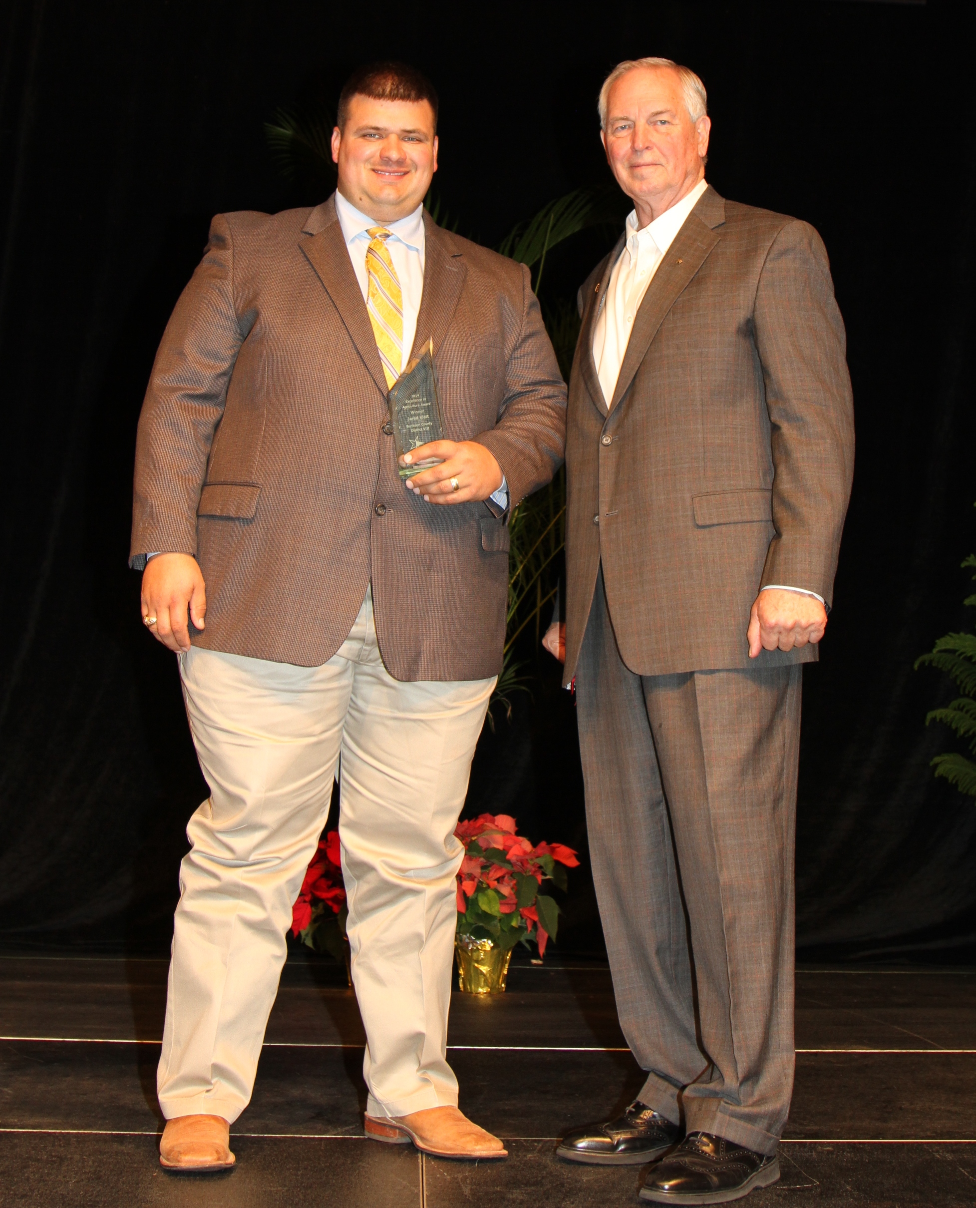 Jared Klatt of Bryan was named Texas Farm Bureau's 2014 Excellence in Agriculture winner.  TFB President Kenneth Dierschke presented the award during the organization's general session.