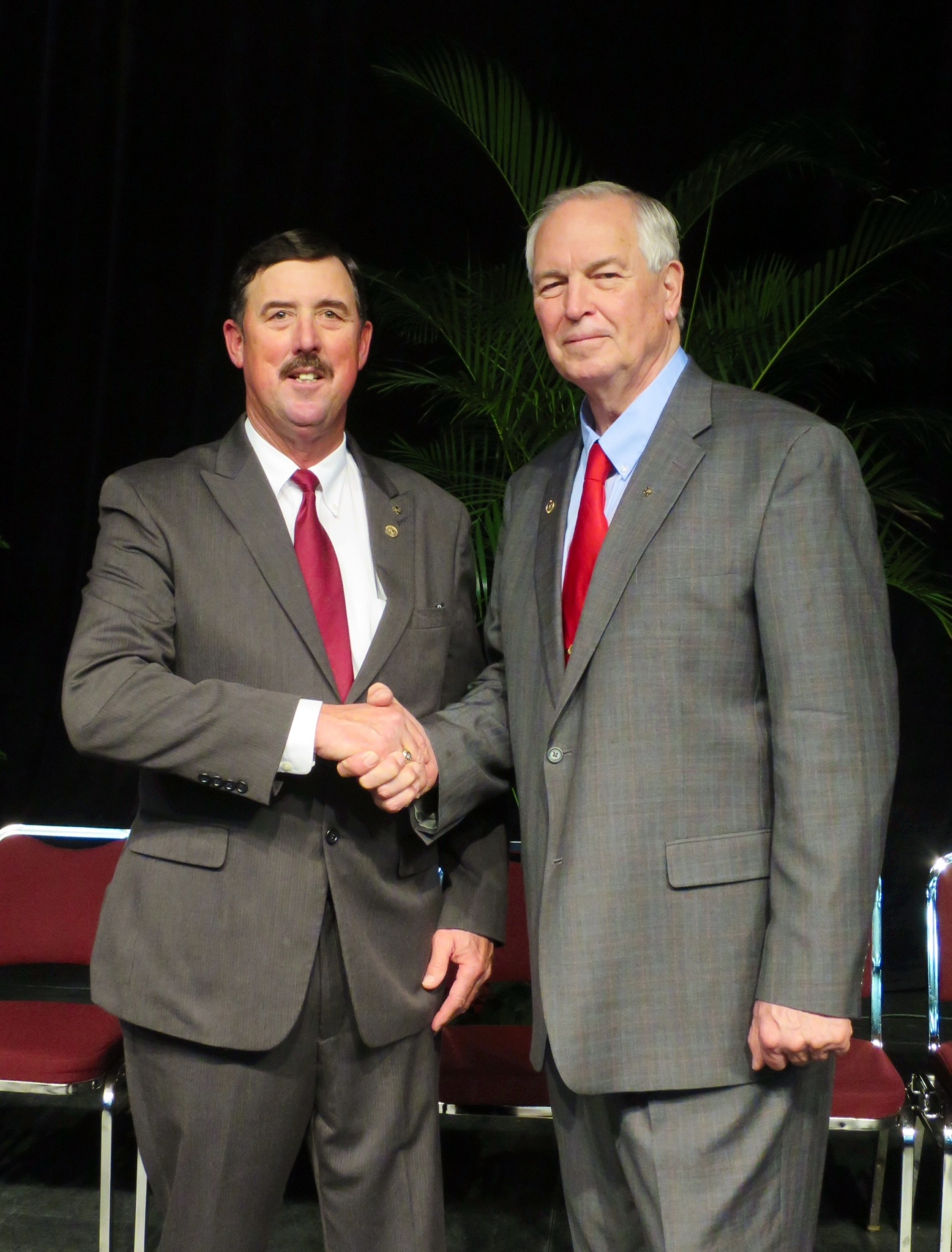 Russell Boening (left)—a South Texas dairyman, farmer and rancher— was elected the 10th president of Texas Farm Bureau. Past President Kenneth Dierschke (right) congratulates him.